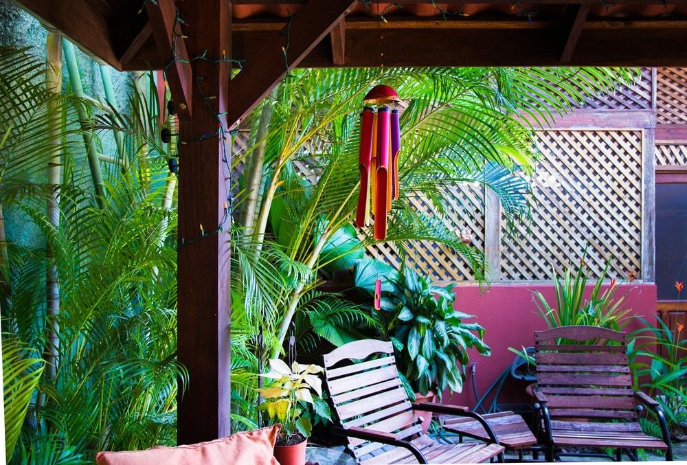 Backyard, tropical pergola. Full color bamboo wind chime