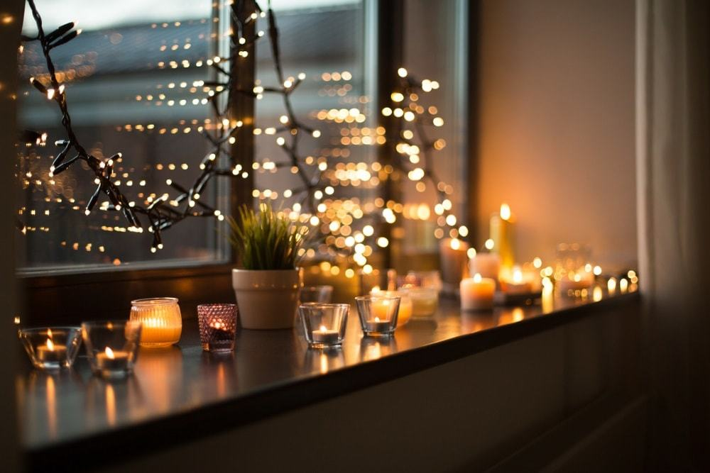 Candles burning in lanterns on window